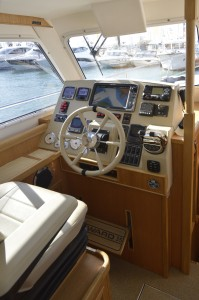 Luxury abounds on the latest Seaward Nelson motor yachts. Shown here is the pilot position on the Seaward 35 E15 which adjusts to accommodate any size person to sit or stand at the wheel.