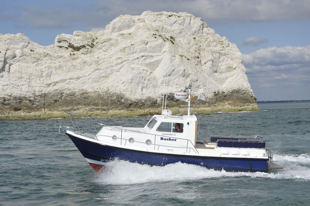The latest Seaward Nelson 25 E 14 twin-screw all-weather motor cruiser at speed off the Needles